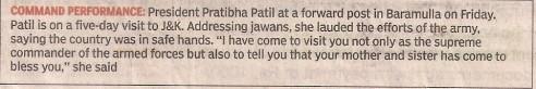 Holding gun, Indian President Pratibha Patil envouraging army men
