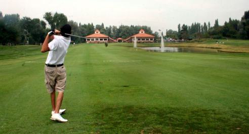 A Golfer in action at Srinagar's famous Royal Springs Golf Course. Photo by Arshad Hussain.