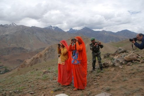 These two ladies from Rajasthan lost their husbands in the war ... they are watching the hills where the men died, for the first time ... Photo & Caption by Neelesh Misra