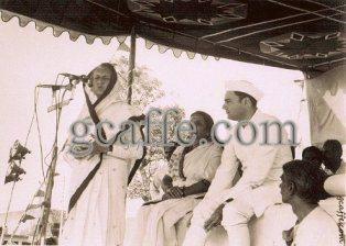 Indira Gandhi and Rajiv Gandhi on a dias giving speech. Photo copyright gcaffe.com