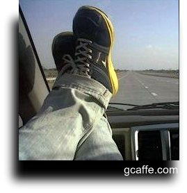 Feet Resting With Shoes On Dashboard. Photo By Geetanjali Kaul For gcaffe.com